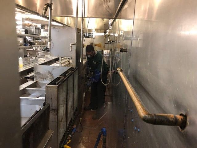 Service Technician Pressure Washing Restaurant Kitchen Floor