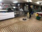 Service Technician Cleaning Restaurant Kitchen Floor